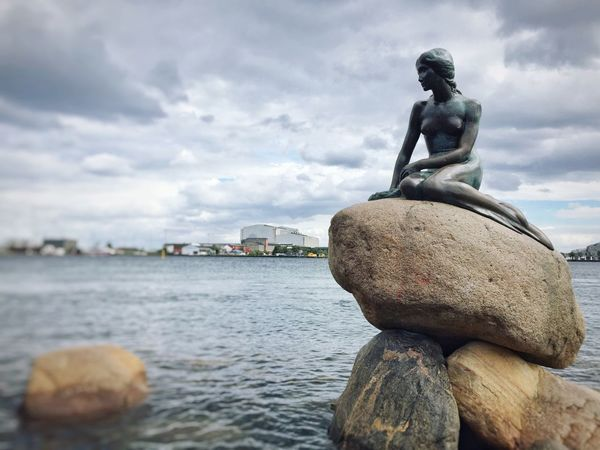 Den Lille Havfrue Little Mermaid  Water Statue Human Representation Sculpture Sky Art And Craft Sea Cloud - Sky Art Stone - Object Rock - Object Creativity Travel Destinations Cloud Day Stone Material Tranquil Scene Vacations Tourism Tranquility Copenhagen