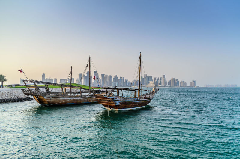 Doha Middle East Architecture Boat Building Exterior Built Structure City Clear Sky Dhow Mode Of Transportation Nature Nautical Vessel No People Outdoors Qatar Sailboat Sea Sky Transportation Travel Water Waterfront Wooden