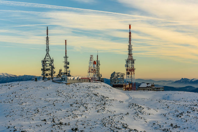 Antenna Architecture Building Exterior Built Structure Cloud - Sky Cold Temperature Day Drilling Rig Industry Landscape Nature No People Oil Industry Outdoors Repeater Tower Scenics Sky Snow Sunset Telecommunication TelecommunicationTower Winter