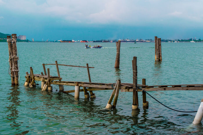 old wood pier and boat Cruise Boat Ocean View Beauty In Nature Cloud - Sky Horizon Over Water Nature Old Pier Outdoors Scenics Sea Tranquility Wood Pier Wooden Post