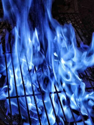 Close-up of fire in blue water