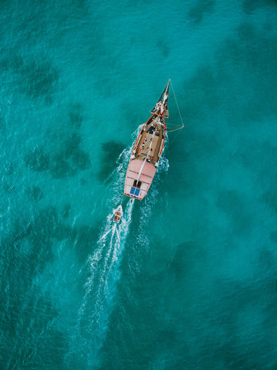 Pirate ship from above at the caribbean ocean Beauty In Nature Day High Angle View Holiday Mode Of Transportation Nature Nautical Vessel Outdoors People Real People Sea Transportation Travel Trip Turquoise Colored Vacations Water Waterfront Women