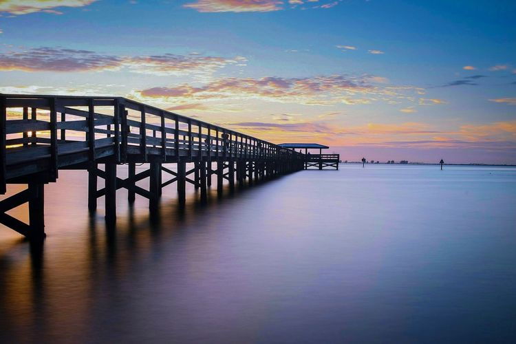 Harbor fishing pier. Sky Sunset Water Sea Cloud - Sky Beauty In Nature Nature Outdoors Railing Horizon Over Water Scenics Tranquility No People Built Structure Tranquil Scene Beach Architecture Day Landscape Photography sunrise Indoors Outdoors