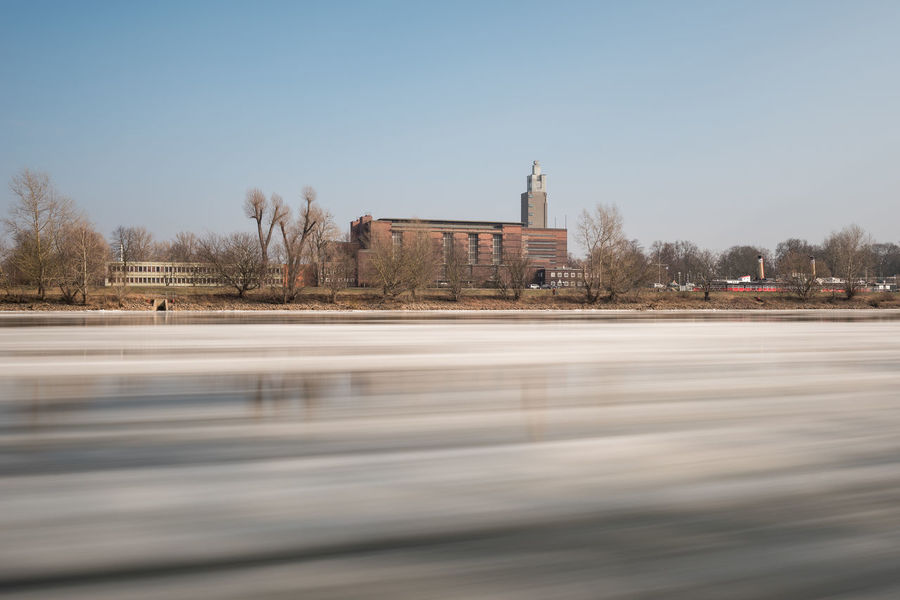 Elbe River Sachsen-Anhalt Architecture Bare Tree Building Exterior Built Structure Clear Sky Day Eisschollen History Landeshauptstadt Long Exposure Magdeburg Elbe Mdr Nature No People Outdoors Sky Travel Destinations Tree Water