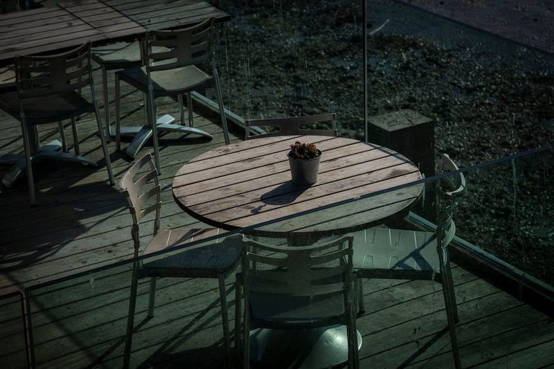 High angle view of chairs and tables arranged in cafe