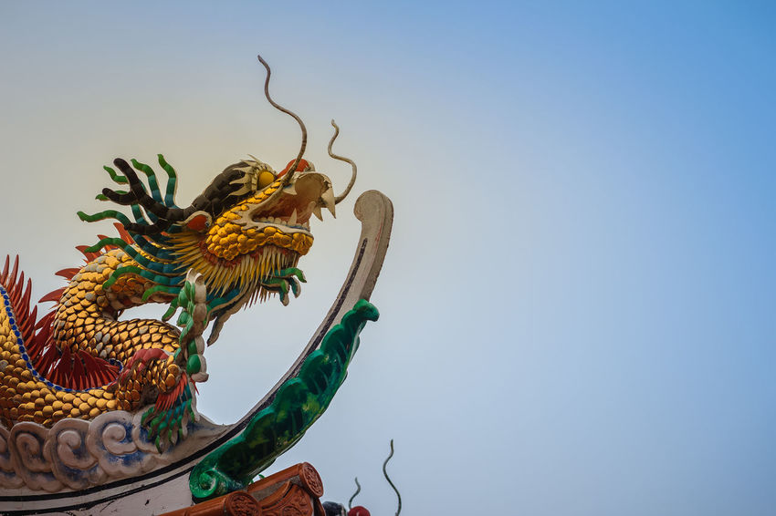 Beautiful statue of Chinese dragon on a roof top in Chinese temple under blue sky background. Blue Sky White Clouds Chinese Temple Ancient Architecture Dragon Dragon Sculpture Dragons Blue Sky Blue Sky And Clouds Blue Sky And White Clouds Blue Sky Background Blue Sky White Clouds As Background Blue Sky With Clouds Chinese Dragon Chinese Dragon Eye Chinese Temple Chinese Temple Decoration Chinese Temples Dragon Scale Dragon Scales Dragon Statue Dragon Statues Dragon Stone Roof Top Roof Top View  Roof Tops