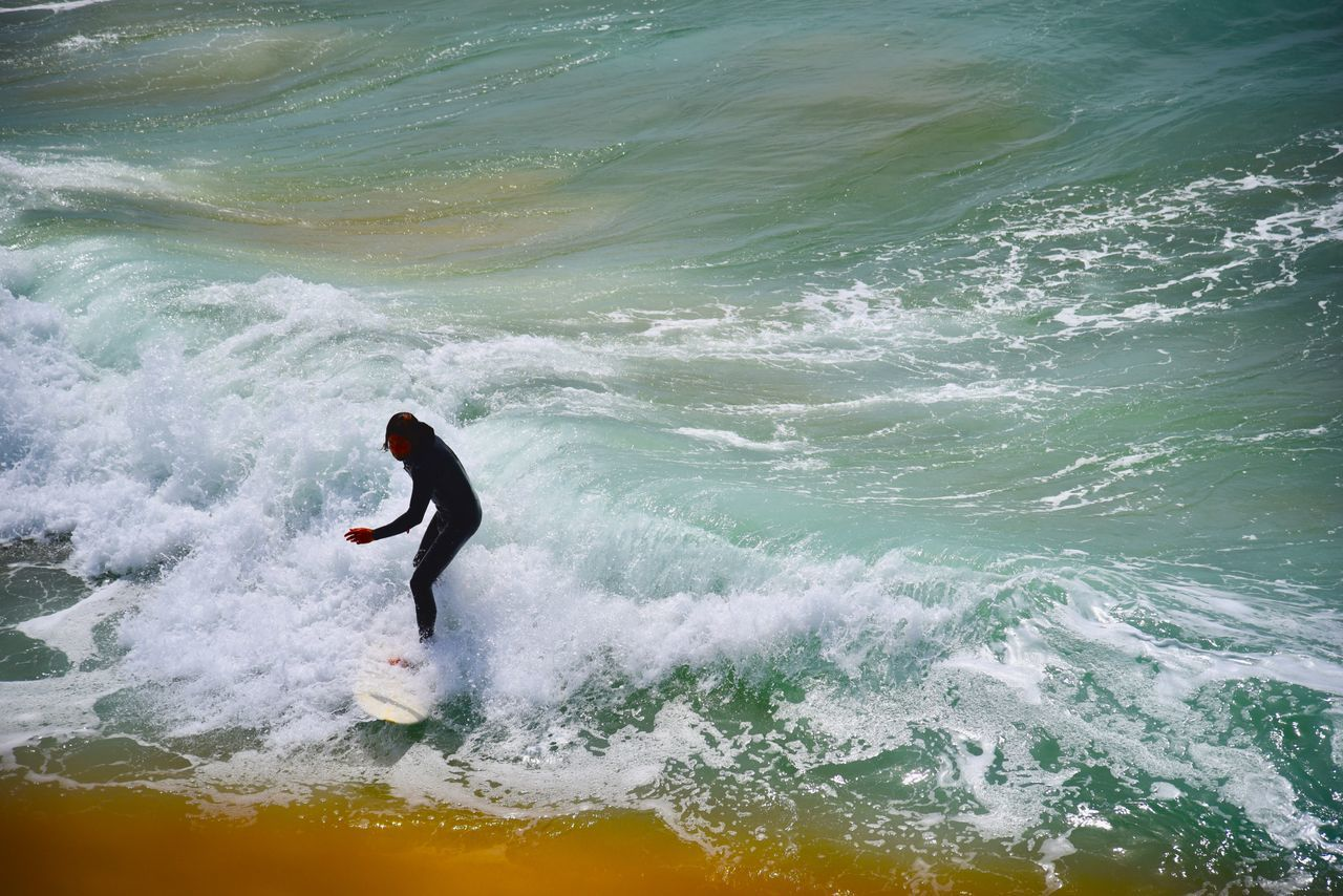 wave, sport, motion, sea, water, aquatic sport, surfing, one person, beauty in nature, lifestyles, waterfront, leisure activity, adventure, real people, sports equipment, nature, day, extreme sports, outdoors, power in nature