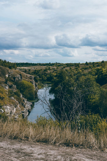 Beauty In Nature Canyon Cloud - Sky Day Grass Growth Landscape Nature No People Outdoors River Scenics Sky Tranquil Scene Tranquility Tree Water