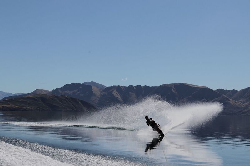 Young man waterskiing in lake