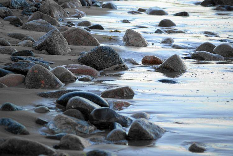 Rocks On The Wet Sand Of A Beach