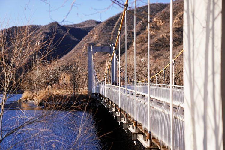 Bridge over snow covered land
