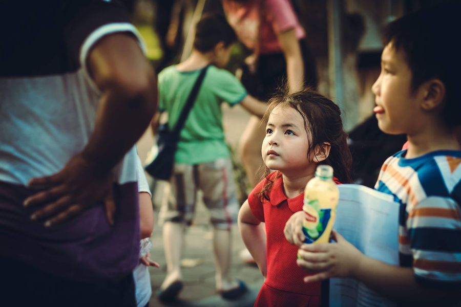 """Little girl practices English skills. """"So, tell me what do you come to Vietnam for?"""" Hanoi Vietnam  Practice Speaking Skill Conversation Little Girl Child Childhood Men Group Of People Real People Females Cute Girls"""
