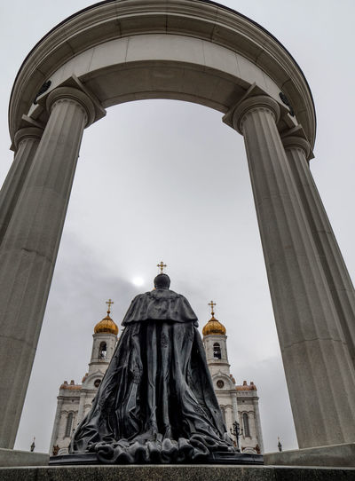 Statue of tsar alexander ii against cathedral of christ the savior