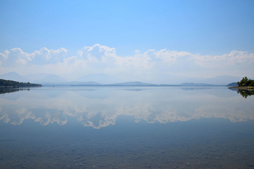 Waterscape at Liptovska Mara lake with clouds reflection in tranquil water Liptovska Mara LiptovskáMara Waterscape Beauty In Nature Blue Cloud - Sky Day Horizon Over Water Idyllic Lake Landscape Nature No People Outdoors Reflection River Scenics Sky Summer Symmetry Tranquil Scene Tranquility Water Waterfront Summer Exploratorium