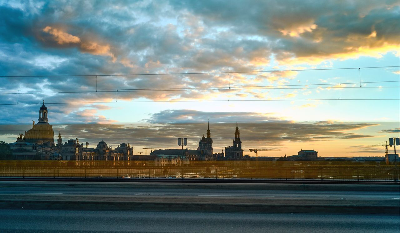 sky, cloud - sky, architecture, building exterior, built structure, city, sunset, travel destinations, place of worship, nature, religion, no people, belief, spirituality, travel, building, tower, outdoors, spire, government