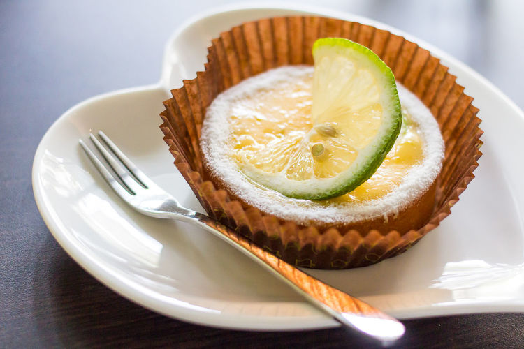 Close-up of served sweet pie in paper plate