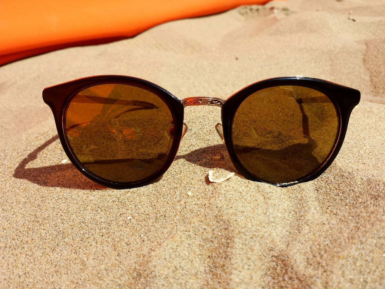 Close-Up Of Sunglasses On Sand