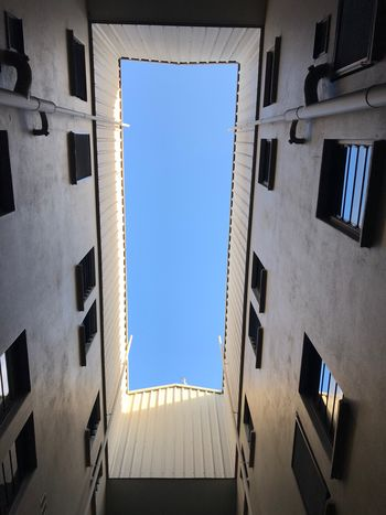 EyeEm Selects Built Structure Architecture Building Exterior Sky Building Window Clear Sky Low Angle View No People Blue Day Sunlight City Wall - Building Feature Directly Below Wall Outdoors A New Perspective On Life