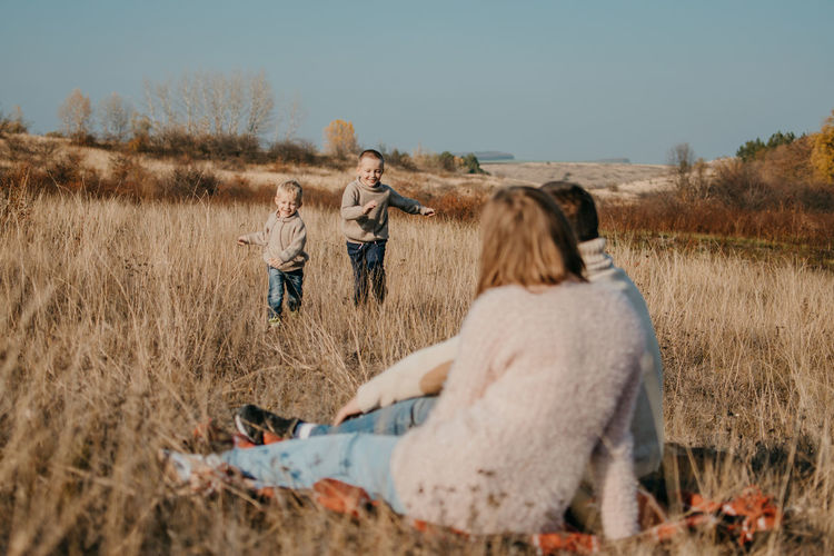 Global day of parents. happy family enjoying together on a sunny day in country.