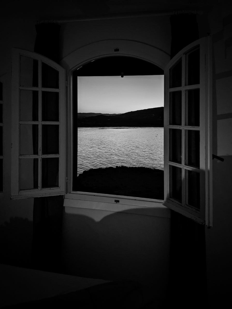 water, window, nature, architecture, no people, indoors, sea, arch, built structure, scenics - nature, sky, day, beauty in nature, open, tranquility, dark, sunlight, entrance