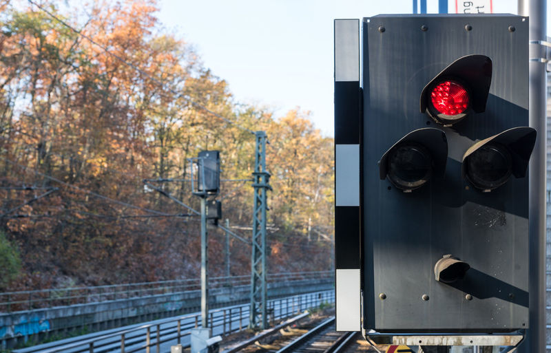 Autumn Day No People Outdoors Rail Transportation Railway Signal Red Light Road Sign Signal Transportation Tree
