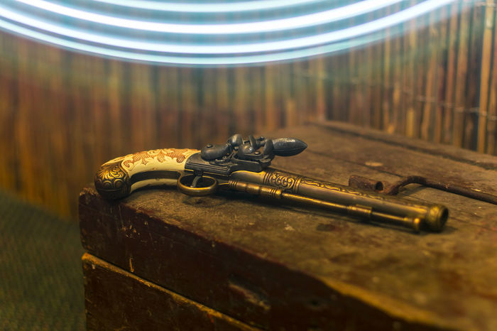 an antique pistol used in 18 century Alpivan Antique Art And Craft Bullet Close-up Collector Craft Craftsmanship  Duel Finesse Fire Gentelmen Gun Haifa Lalalama No People Old-fashioned Old-fashioned Pirate Pistol Poetic Reliable Timeless Treasure Chest Weapon