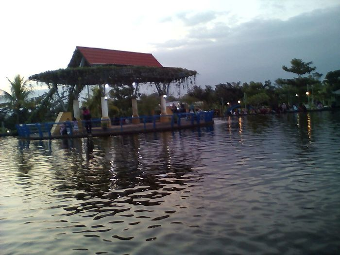 taman bale kemambang Water Architecture Building Exterior Floating On Water Lake Nature Tree Built Structure Sky Outdoors Stilt House Day People EyeEmNewHere