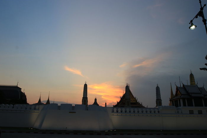 Beautiful light in the evening above wat phra keaw in Bangkok,Thailand Beautiful Light In The Evening Bright Land Mark Sanam Luang Bangkok Travel Wat Phra Keaw Architecture Blue Sky Building Exterior Built Structure City Cloud - Sky Day Destination Emerald Budhha Temple Famous Place Golden Light Light And Shadow Nature No People Orange Light Outdoors Palace Sky Sunset