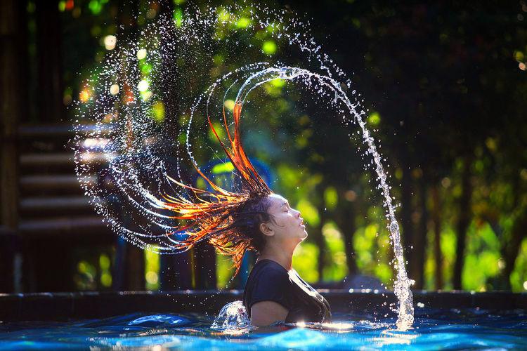 splash water The Creative - 2018 EyeEm Awards Water Spraying Swimming Pool Motion Splashing Droplet Fun Long Exposure Women Drop Standing