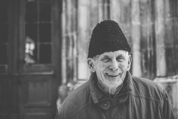 Close-up portrait of smiling senior man