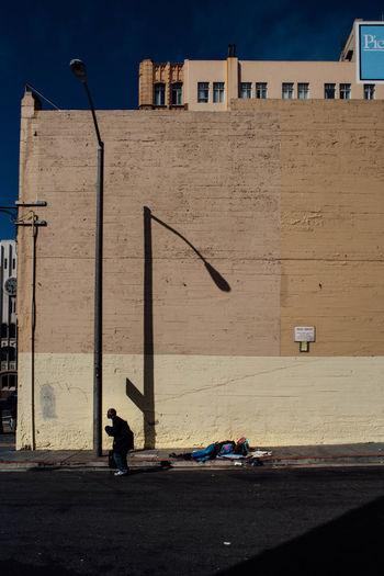 Private Property Architecture Building Exterior City Life Day Diving Homeless Outdoors Political Commentary Politics Portrait Road Shadow Sunny Walking