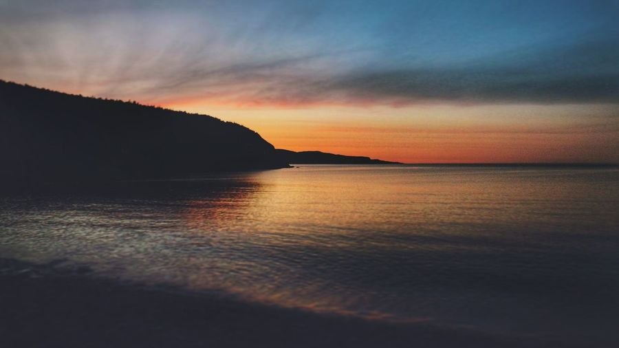 Missing Summer beach fires and ocean side sunsets right about now. Sunset Reflection Ocean Landscape Outdoors Dramatic Sky Beauty Beauty In Nature Cloud - Sky Water No People Mountain Refraction Nature Day