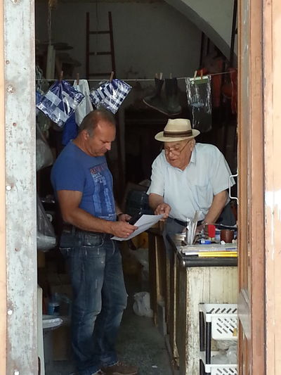 Yvan Moallic - Ymo Kalymnos Kalymnos 2018 Adult Business Casual Clothing Cooperation Coworker Holding Indoors  Kalymnosisland Males  Mature Adult Mature Men Men Mid Adult Mid Adult Men Occupation People Real People Small Business Standing Teamwork Two People Uniform Working