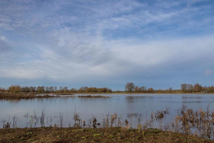 Calm lake against sky
