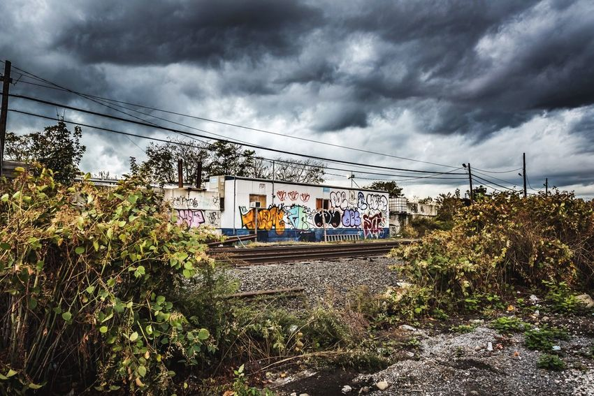 Cloud - Sky Sky Rail Transportation Outdoors Day Built Structure Storm Cloud Plant Men Real People Architecture Nature Tree People Artist ArtWork Art Is Everywhere Arts Culture And Entertainment Art Lifestyles Photographer Graffiti Graffiti Art Fashion Style