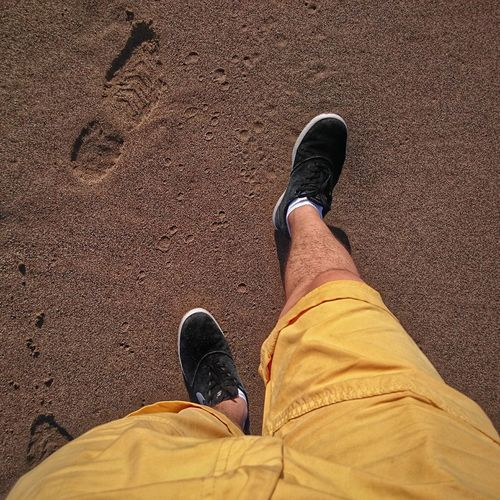 Human Leg Shoe Human Body Part One Person Human Foot Standing Personal Perspective Sand Real People Lifestyles Shadow People Men Day Outdoors Adult Sand & Sea Walking Walking On The Beach Walking On The Sand