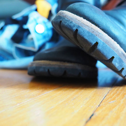Long Day at the Office #EyeEmNewHere Boots Clothes Off Jeans Boots And Jeans Close-up Day Focus On Foreground Hardwood Floor Home From Work Indoors  Long Day At Work  Soft Focus Undressed Wood First Eyeem Photo
