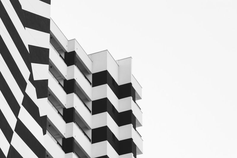 Black And White Façade Urban Landscape Urban Geometry Built Structure Building Exterior Low Angle View Sky Architecture Copy Space Pattern No People Clear Sky Day Building Office Building Exterior Outdoors Office Repetition City In A Row Modern White Background The Architect - 2018 EyeEm Awards The Still Life Photographer - 2018 EyeEm Awards The Creative - 2018 EyeEm Awards #urbanana: The Urban Playground 17.62°