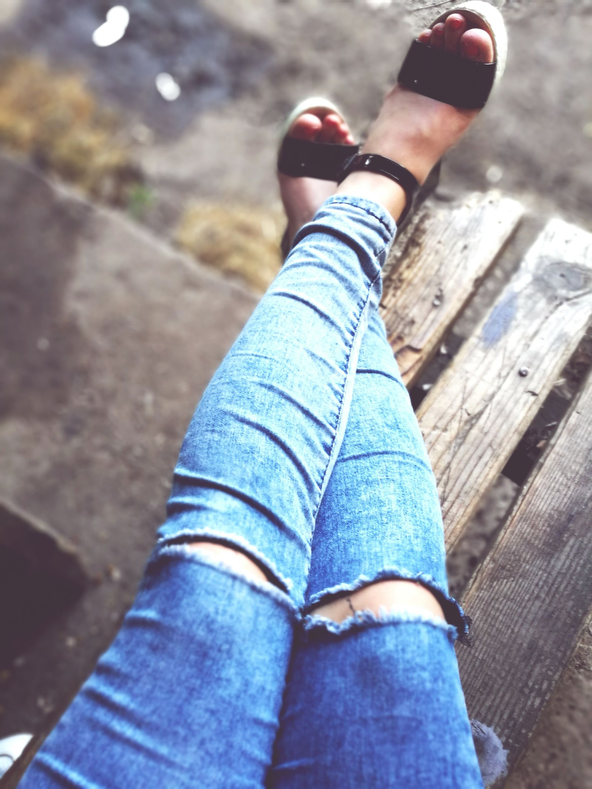 low section, person, shoe, personal perspective, jeans, lifestyles, standing, human foot, men, part of, leisure activity, footwear, wood - material, blue, close-up, unrecognizable person, casual clothing