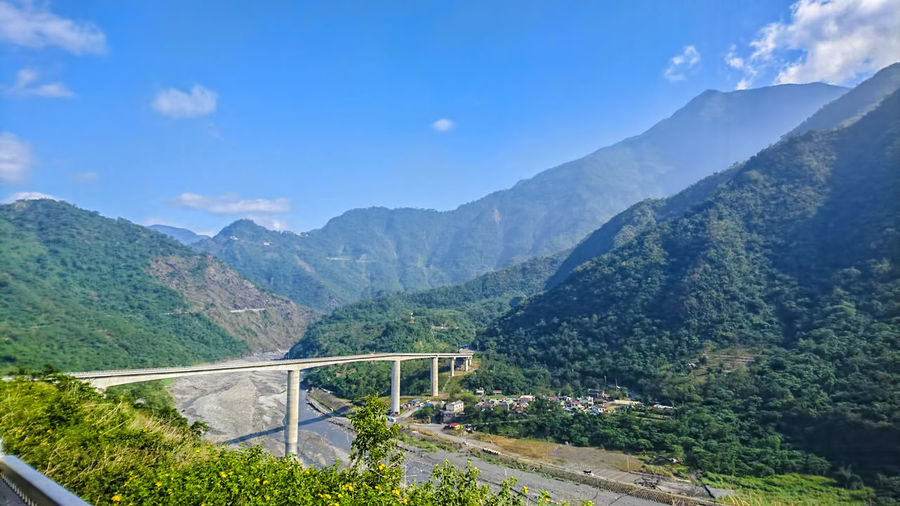 Architecture Beauty In Nature Bridge - Man Made Structure Cloud - Sky Day Landscape Mountain Mountain Range Nature No People Outdoors Road Scenics Sky Transportation Travel Destinations Tree Winding Road
