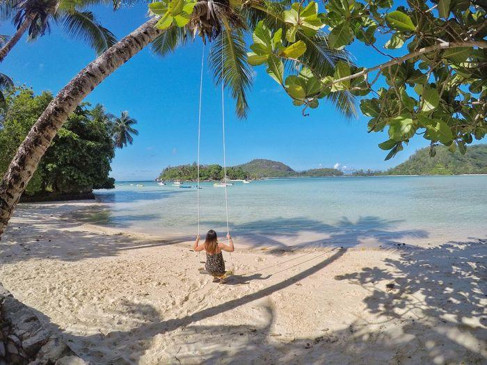 Woman swinging at beach