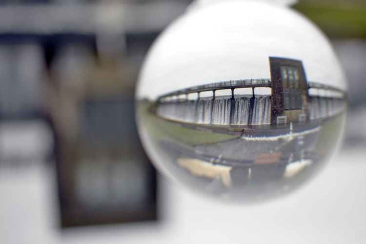 Close-up Reflection Glass - Material No People Selective Focus Sphere Day Architecture Built Structure Outdoors Nature Focus On Foreground Building Exterior Glass Table Transparent Still Life Crystal Ball Shape Ball Cefni Lens Ball