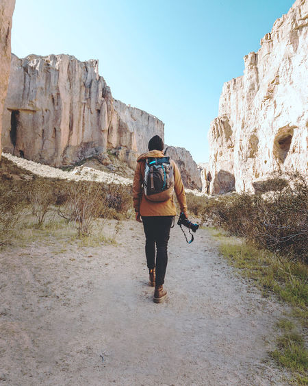 Adult Adults Only Adventure Backpack Beauty In Nature Challenge Clear Sky Climbing Day Full Length Hiker Hiking Leisure Activity Lifestyles Men Mountain Nature One Person Outdoors People Real People Rear View Rock - Object Sky Walking