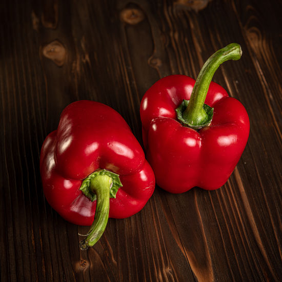 High angle view of red bell peppers on table
