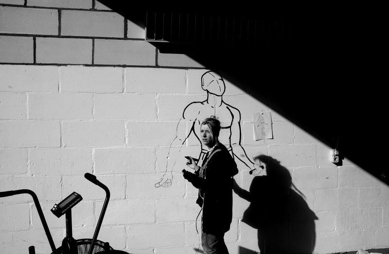 Woman standing against drawing on wall