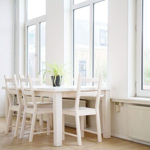 Table and chairs by window
