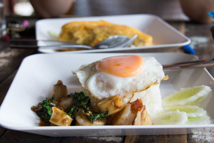 Close-Up Of Fried Egg With Calamari In Plate On Table