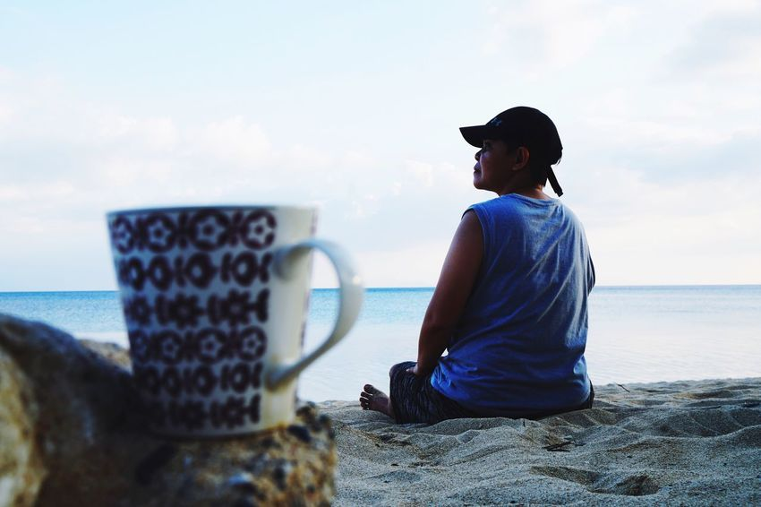 coffee at the beach Travel Destinations EyeEm Phillipines Eyeem Philippines EyeEm Nature Lover EyeEm Best Shots EyeEm Gallery Travelling Travel One Person Real People Lifestyles Water Sky Leisure Activity Sea Cup Beach Coffee Cup Looking At View