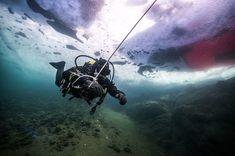 Scuba Diver Holding Rope Under Water