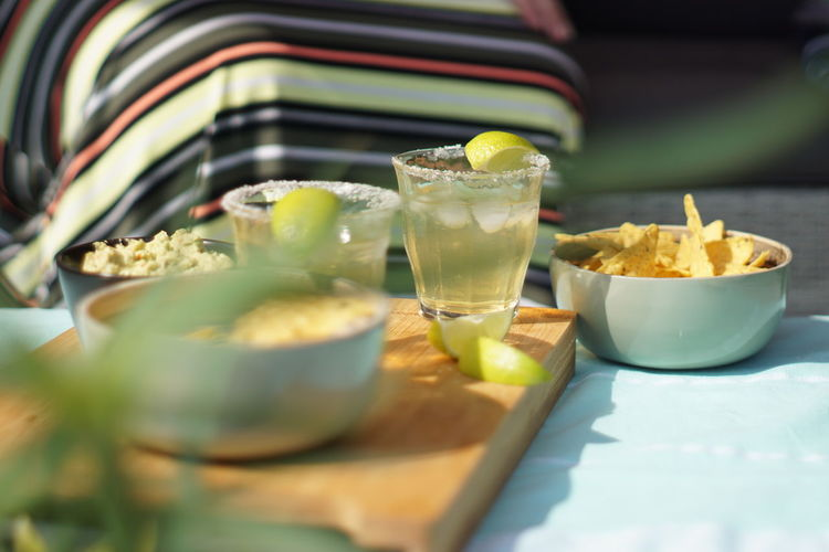 Cerveza Limes Bowl Drink Drinking Glass Fiesta Food Freshness Glass Guacamole Margaritas Meal Mexican Food Nacho Chip No People Ready-to-eat Refreshment Selective Focus Serving Size Snack Still Life Table Temptation Tray Wellbeing